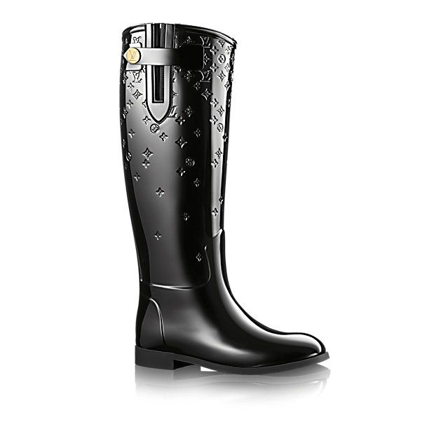 Louis Vuitton: Drops Flat High Boots for $490. Rain boots. Fall outfit. See more rain boots >>> http://justbestylish.com/13-perfect-rain-boots-you-cant-live-without/