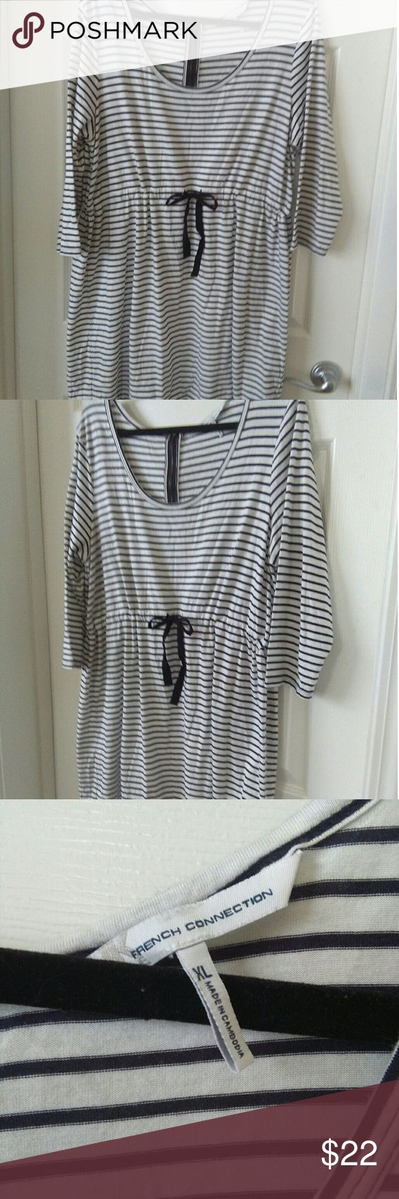 Uk French Connection Dress Adorable black & white striped dress with drawstring tie.  Zippered back.  Cute with tights or leggings.  Great condition. French Connection Dresses Midi