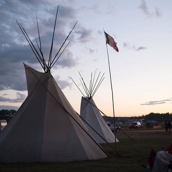 """This evening the Sun says """"I hope to see those tipi poles standing tall just before sunrise tomorrow"""".  #tipi #evening #tipipoles #StandingRock #AIM #AmericanIndianMovement #TrystanFoundation #Sunset #Flag #Flagpole #Tradition Trystan Foundation #TrystanFoundation Trystan Foundation Pic Photo"""