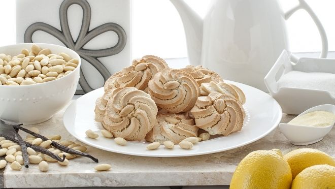 Amigdalota is the Greek version of an almond macaroon.  These are delicious and should be kept refrigerated and removed about 10 minutes before serving.