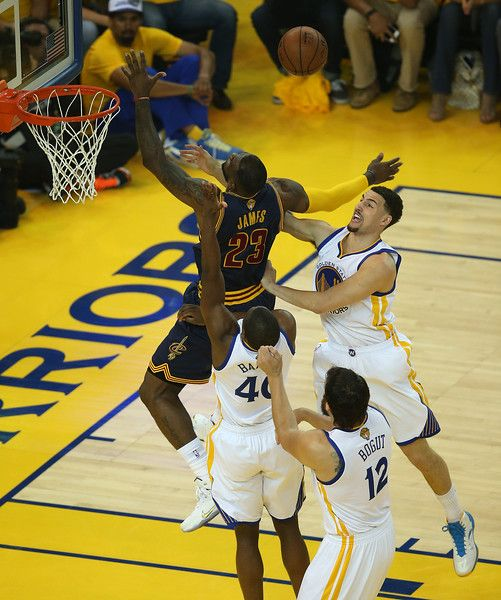Golden State Warriors' Klay Thompson, (11) Harrison Barnes (40) and Andrew Bogut (12) try to stop Cleveland Cavaliers' LeBron James (23) from scoring as he loses control of the ball in the first quarter of Game 1 of the NBA Finals at Oracle Arena in Oakland, Calif., on Thursday, June  4, 2015. (Jane Tyska/Bay Area News Group)