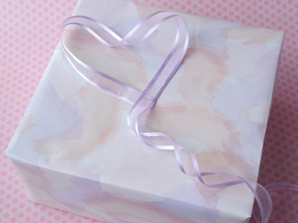 Soft, feminine tones of pink, peach & lilac on gift wrap