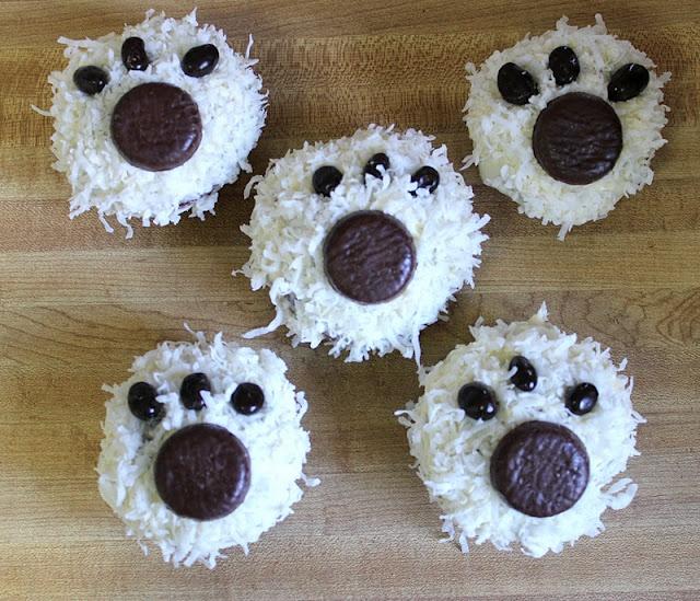 Polar bear cupcakes- Love the Peppermint patty pawprints! #dog #puppy #animal