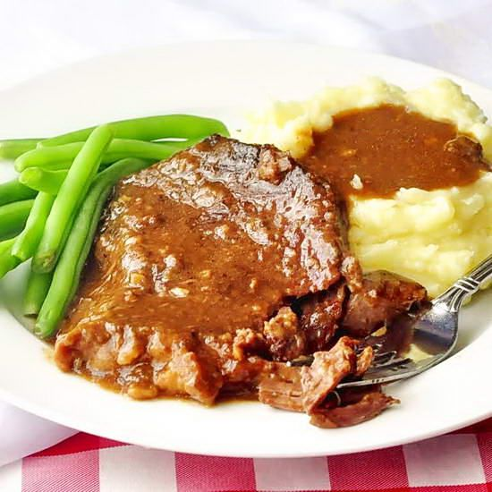 From the oven or slow cooker it's one of my absolute favorite winter comfort food meals. Lean cuts of steak slowly braised in beef stock to form a rich gravy and tender beef. Delicious and satisfying in every way.