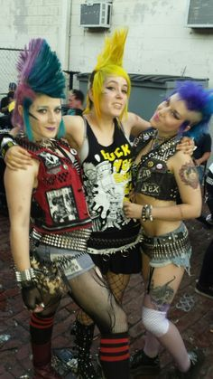Graphic tees, ripped shirts, bullets and studs, multi colored hair, tights, chunky bracelets