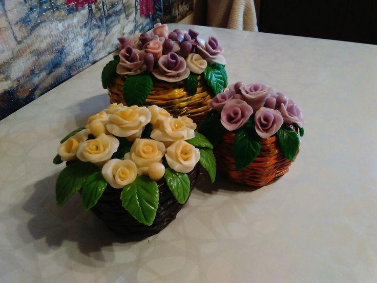 Sugar paste roses in news paper bascket
