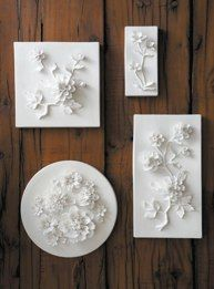 Porcelain Flower PlaquesBeautifully modeled flowers made from paper thin porcelain.  Each petal, leaf and stem is created in the palm of an artisans hand.Designed in 2006