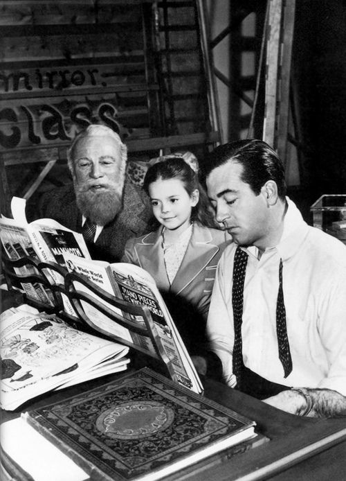 Edmund Gwenn, Natalie Wood, and John Payne behind the scenes of the 1947 movie Miracle on 34th Street.