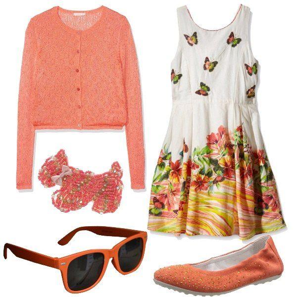 Outfit formato da un abito in cotone multicolore con stampa ispirata alla natura, un cardigan in arancio, un paio di ballerine arancioni con strass dorati, un paio di occhiali da sole in arancione e una molletta simpatica a forma di cane con perline color corallo.