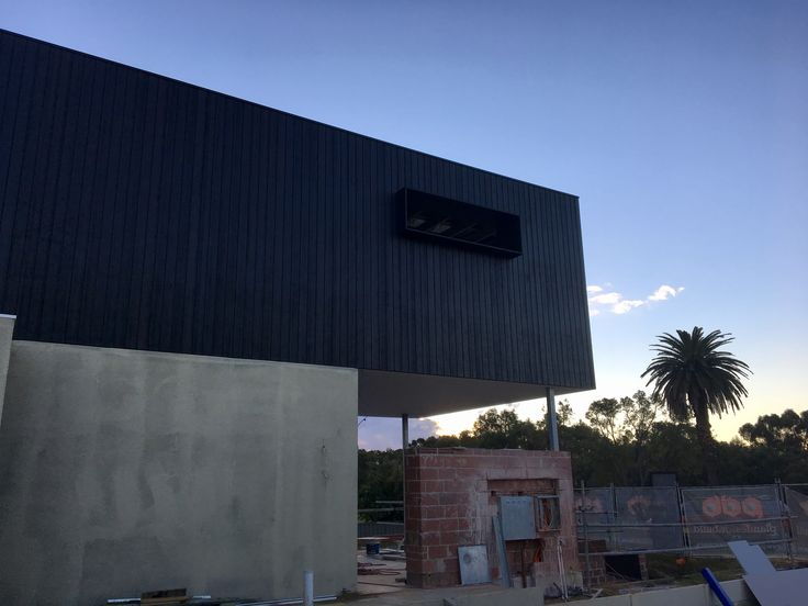 'Black Box' home under construction in Perth WA, Vulcan Cladding in Ebony Oil. #austimtimber #austimtimbers #austim #abodowood