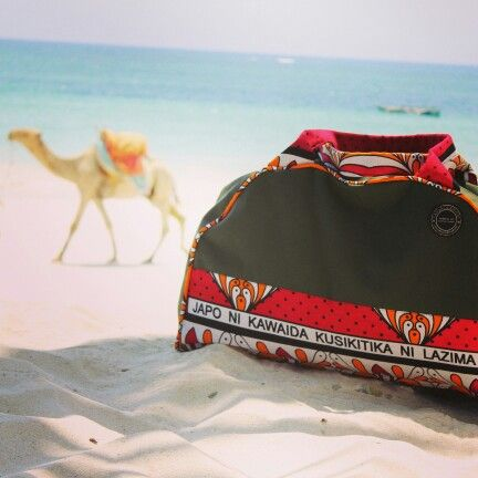 Camels and bags....only in Kenya. This is our big travelbag in green canvas. Canvas & Kangas. CanvasandKangas.com. Made with a smile.