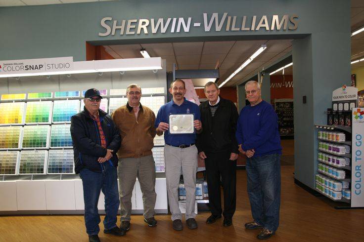 Representatives from the Lackawanna County Veterans Affairs Office and the Tobyhanna Army Depot Retirees Breakfast Club presented a Certificate of Appreciation to James Shock, center, Manager of the Sherwin-Williams South Scranton paint store, for donating the paint to refurbish the Jessup Borough tank located on Hill Street.