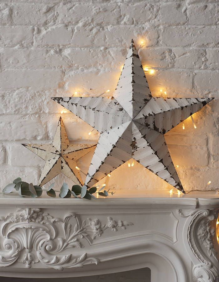 Love this fireplace mantle. Wrap fairy lights around a picture frame, doorway or one of these Vintage Style Amish Tin Barn Stars to create a subtle lighting feature.