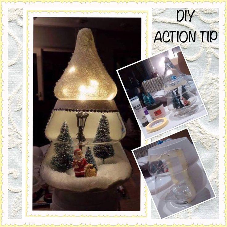 De kerstman zit in een setje met lantaarn, Lichtjes in punt is snoertje batterij lampjes 10 stuks en boompjes, sneeuw, gesso, verf alles komt bij Action vandaan..