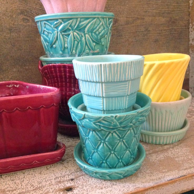 """Vintage McCoy Pots in a rainbow of colors.  I always love playing """"I Spy"""" with other people's collections.  How many patterns do you know? ~ Mary Walds Place - I Love Collecting: FLOWER POTS!"""