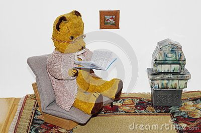 Teddy bear Morulet reading  The bear is bought from the supermarket 50 years ago.