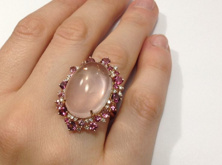 This stunning ring features a 22.97ct cabochon rose quartz surrounded by dazzling white diamonds and pink tourmalines.
