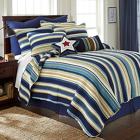 The Ryan quilt features a striped blue pattern in a palette of inviting colors, making it a masculine addition to any young man's bedroom.