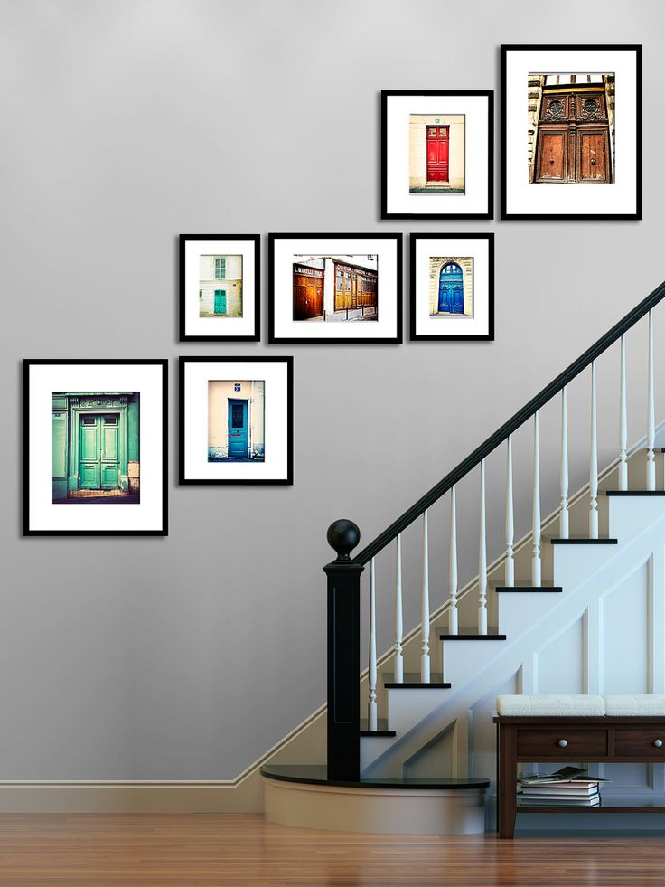 Photo Gallery - Stairs Like the lines: frame bottoms level on top row, frame tops and bottoms level (though not exactly here) in middle row, and frame tops level on bottom row. Simple idea, but very nice. Great colors, too, with stairs also painted different color from walls.