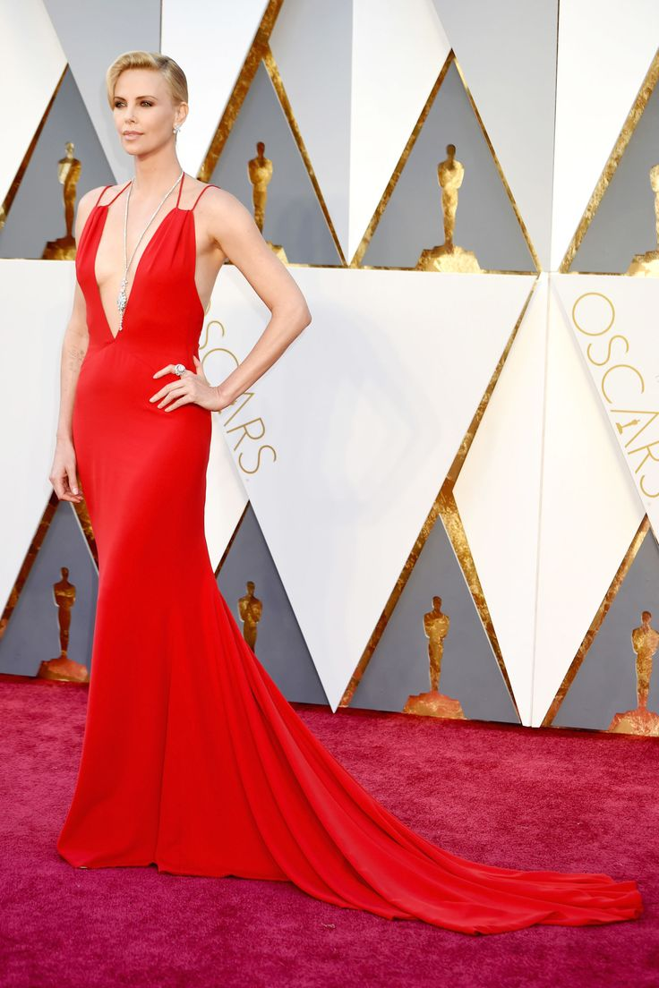 The Mad Max star was truly statuesque in a plunging red Christian Dior gown accessorized with a perfectly-placed diamond pendant