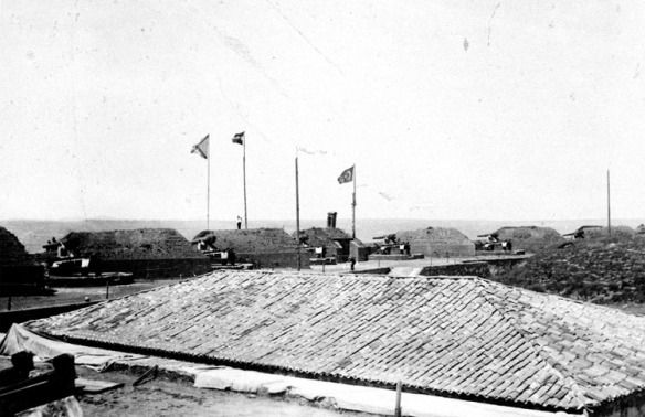Fort Izzedin 1897. Showing flags of the occupying Powers.