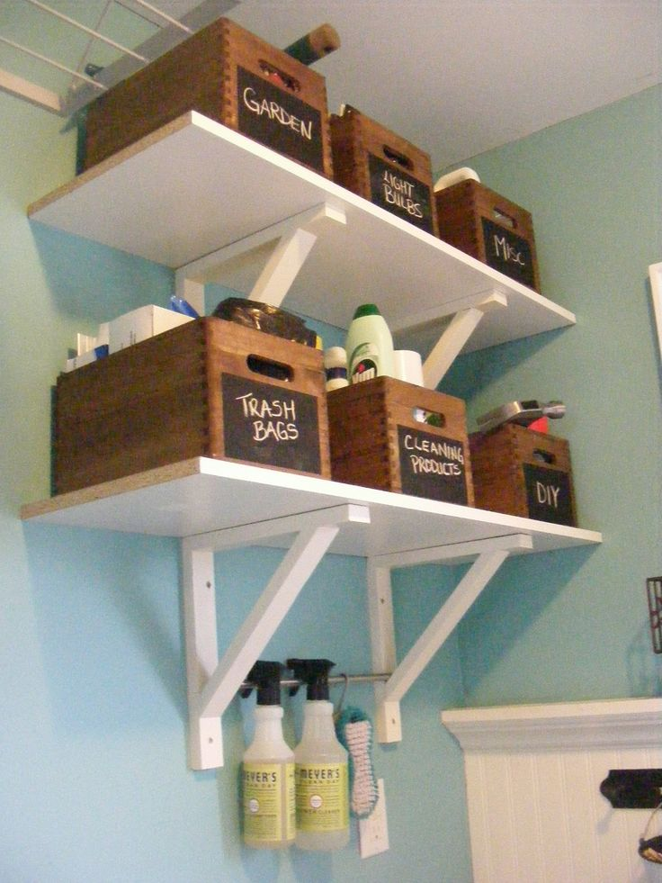 laundry room shelving and organization . . . crates (various sizes from Michaels for things like light bulbs, batteries, extra fabric softener sheets, beach/carry-all bags, pool toys, bug spray/sunscreen/first aid kit. Paint in white, yellow, green and grey stripes.
