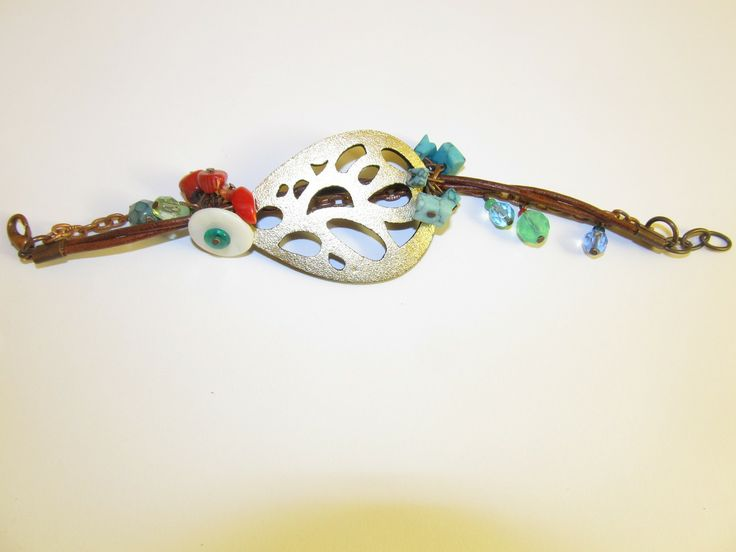 Handmade laser cut leather bracelet (1 pc)  Made with gold leather filigree, corals, turquoise stones, mother of pearl, glass beads and leather cords.
