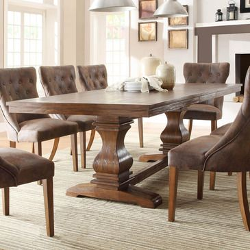 With inspiration drawn from traditional French decorative accents the effortlessly elegant Marie Louise Collection adds warmth and charm to your dining room. A classic urn double pedestal trestle base acts as the focal point of the collection. The rustic weathered oak finish on the pine veneers...