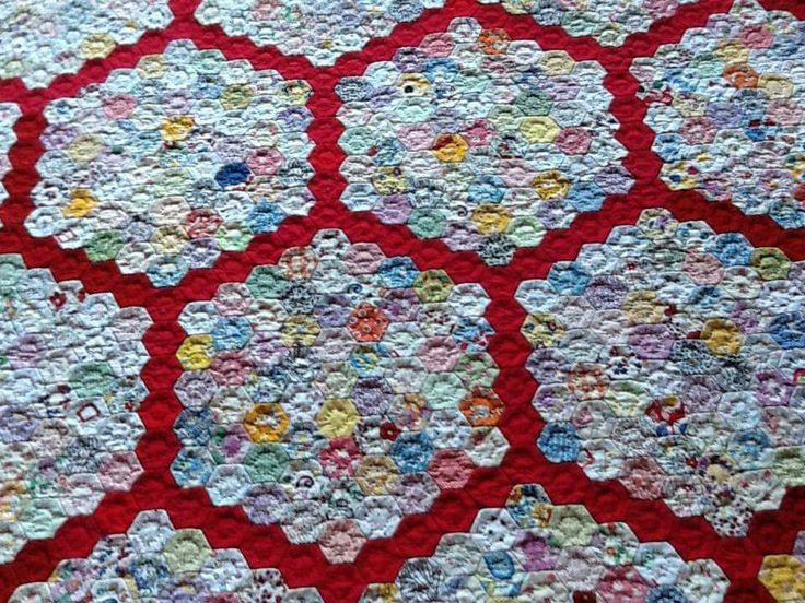 Hexagon quilt, love the red.