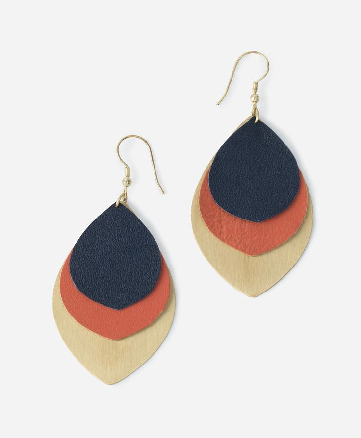 Leather petals in shades of navy and coral are anchored by a handcut metal teardrop.   Revelry Earrings