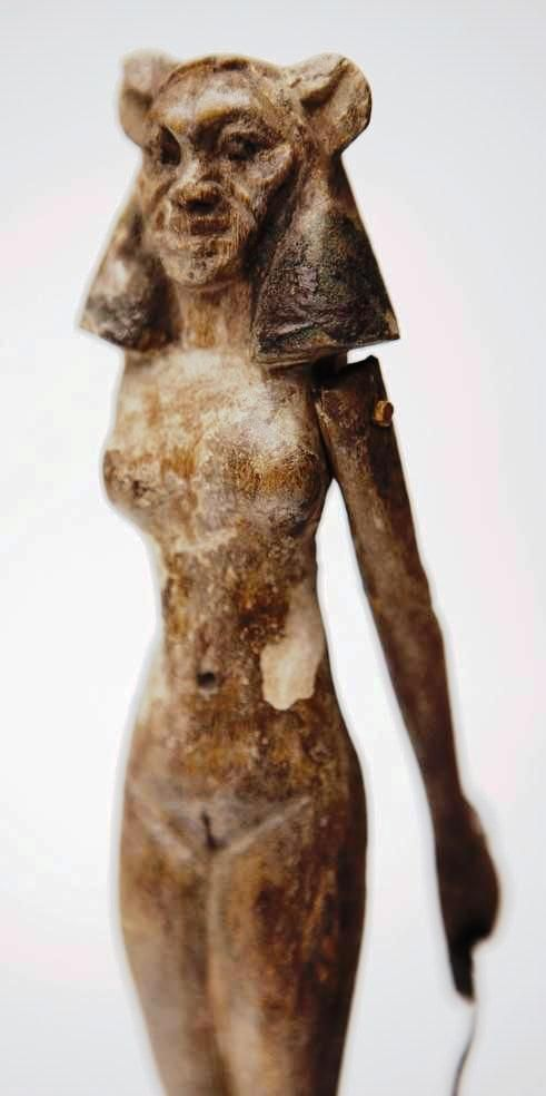 An Egyptian wooden figurine of a woman with lion's face and movable arms. Most likely the Lion-headed Goddess Sekhmet (also spelled Sachmet, Sakmet, Sakhet, Sekmet, Sakhmet and Sekhet; and given the Greek name, Sachmis).