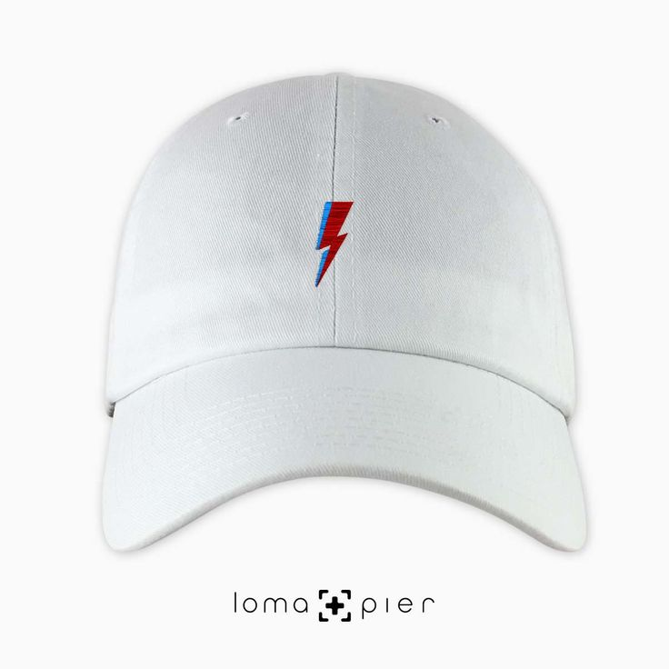 LIGHTNING BOLT typography embroidered on a white unstructured dad hat with multicolor thread by loma+pier hat store made in the USA. LIGHTNING BOLT dad hat is 100% cotton unstructured with a pre-curved bill and an adjustable self strap with a hide-away side buckle. it features EDGY HEART typography embroidered on the front with a small loma+pier logo on the left side. each order is custom made in the USA and can only be found in the loma+pier hat store.