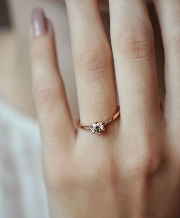 I love the size of the diamond (it's the exact size I'd like), but I also like how thin the band is.  ANNA SHEFFIELD