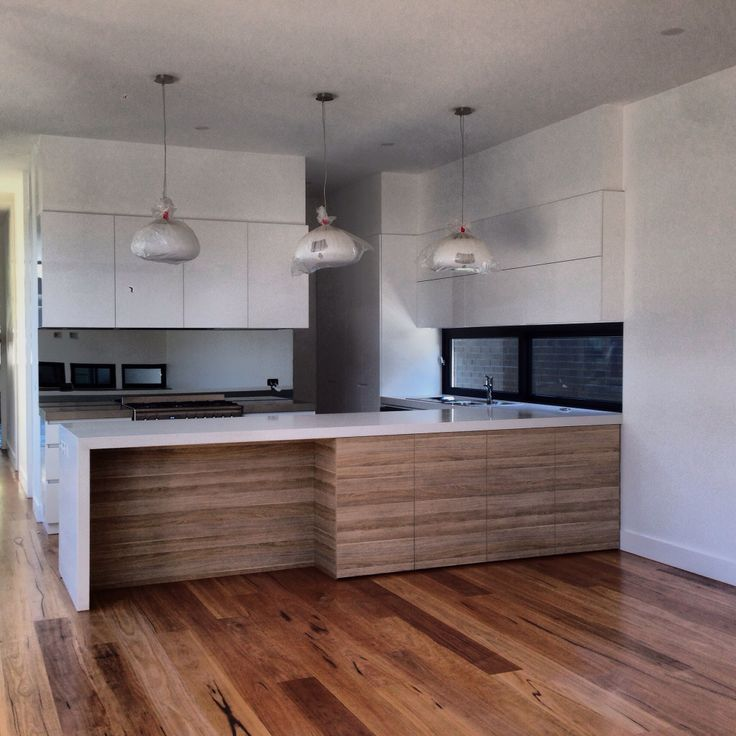 Beaumaris project - Kitchen - Spotted gum flooring leading I to open kitchen/meals. timber floor with timber veneer.  Not sure about this.
