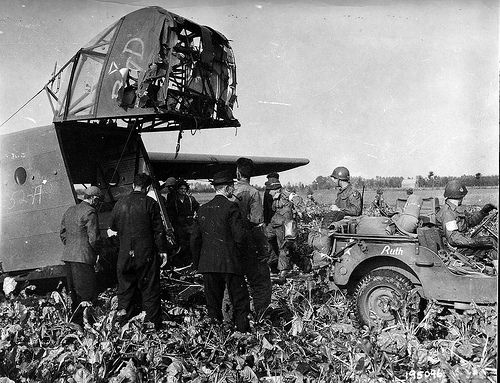 "Market Garden18th September 1944.  American freight landing CG-4A WACO glider after landing on the field near the Dutch city of San (Son) damaged the nose, but a jeep named ""Ruth"" airframe and crew on board survived. Next to the glider are three local residents who helped them unload."