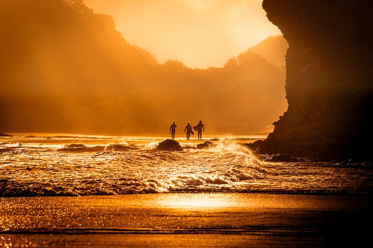 End of the day, surfers, Bethell's Beach