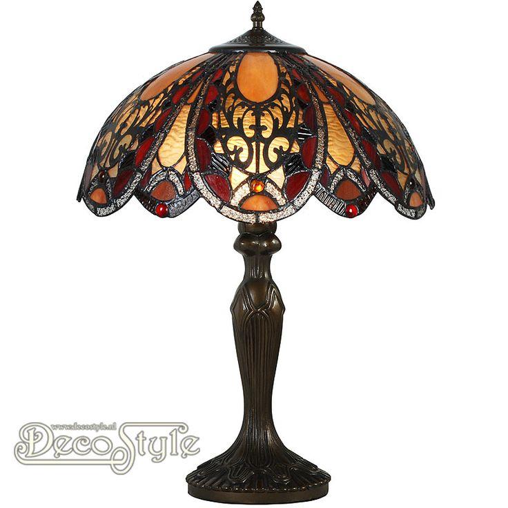 Tiffany Tafellamp Falcon Victorian  Een bijzonder mooie tafellamp. Helemaal met de hand gemaakt van echt Tiffanyglas. Dit originele glas zorgt voor de warme uitstraling. De voet is bronskleurig. Met grote fitting (E27) Max 60 Watt. Met schakelaar aan het stroomsnoer. Afmetingen: Hoogte: 59 cm Breedte: 40.5 cm Diepte: 40.5 cm