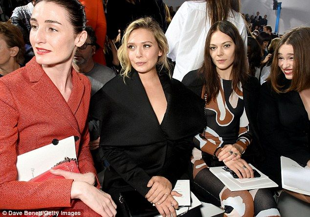 Star-struck: Emilia looked thrilled as she took up a pew on the front row alongside (from left to right) Erin O'Connor, Elizabeth Olsen and Kinga Rajzak