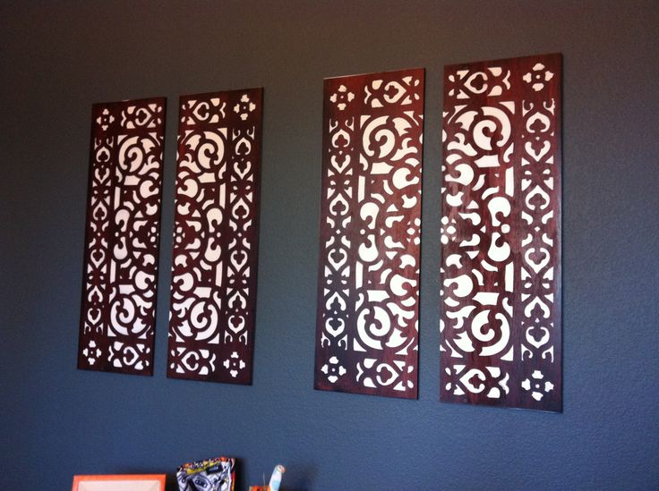 DIY Wall Art- Bought an outdoor rubber mat from Lowes. Had 1inch thick wood cut down to the size of the mat. Stain wood then place mat on wood and spray paint 3 coats. Done! Instant wall art!