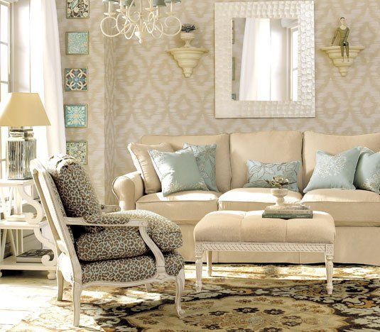 romantic cream and light blue living room with chandelier