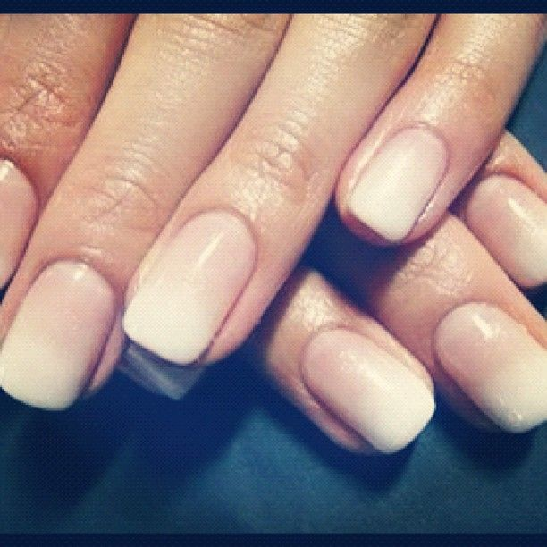 A french manicure done with a matte ombre effect.