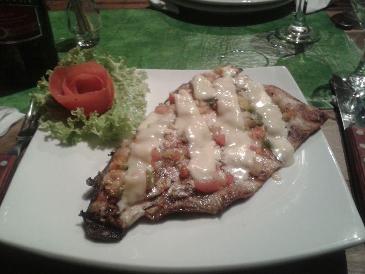 Pacu assado. Um prato do dia no restaurante Vaca Enamorada, Puerto Iguazu - ARG