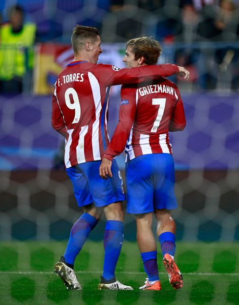 Antoine Griezmann of Atletico Madrid (R) celebrates scoring his sides second goal with Fernando Torres of Atletico Madrid (L) during the UEFA Champions League Group D match between Club Atletico de Madrid and FC Rostov at Vincente Calderon on November 1, 2016 in Madrid, Spain.