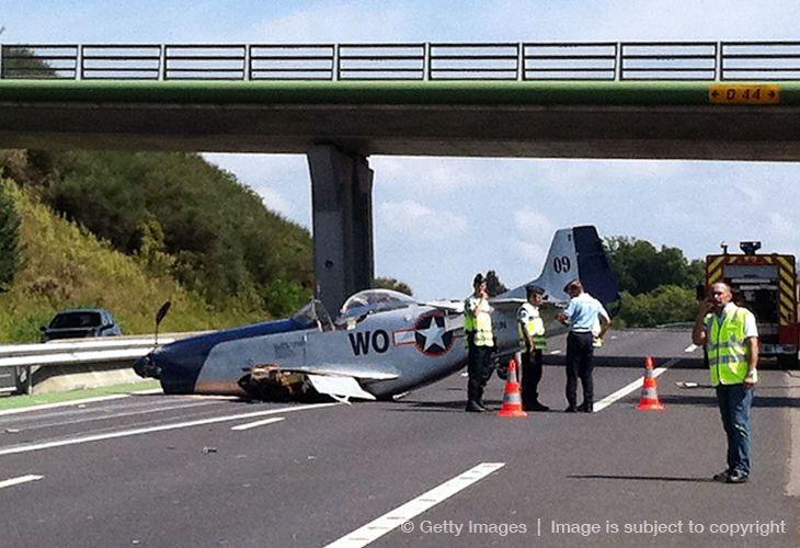P-51 crash lands on a freeway.
