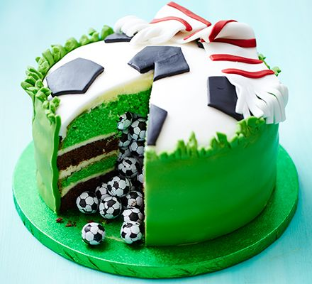 Surprise piñata football cake. Slice into this sensational mint chocolate celebration cake and let the hidden sweets pour out for your party guests to enjoy.