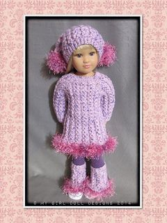 """""""Adelle"""" is an interesting sweater set consisting of a tunic length sweater dress, Jester style hat with matching flared legwarmers. Knitted top-down, back and forth with full back buttoning for reversed wearing. This beautiful pattern features a false eyelet cable stitch (a personal favourite) and is edged with eyelash yarn. Pompons are knitted and attached to the tails"""" of the Jester hat……..with no need for stuffing as the eyelash yarn on the inside of each pom-pon becomes an instant ..."""