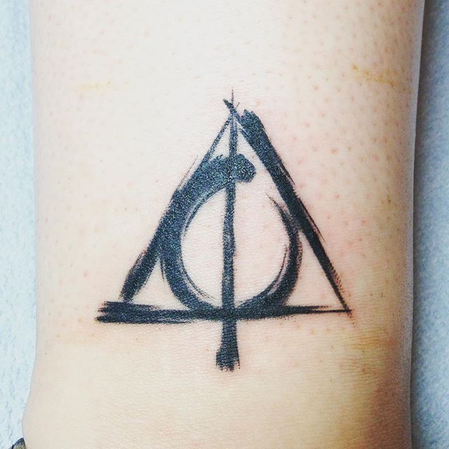 """""""We're all human, aren't we? Every human life is worth the same, and worth saving."""" - Harry Potter and the Deathly Hallows #newesttattoo #8 #deathlyhallows #harrypotter #harrypottertattoo thanks @sharpieninja for another fun session! Seriously if you guys are in the San Diego area and are needing a tattoo in your life go see him at @truefittattoo"""