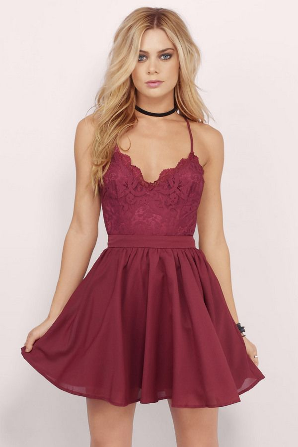 The Mila Dress is part romance, part sass. This skater dress features a lacy bodice and criss-cross back straps. Own the night with some strappy heels to compliment the look.. Get 50% off your order when you join Tobi.com