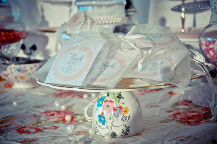 Inverted vintage tea cup makes a great plate stand by www.prettylittlevintage.com.au