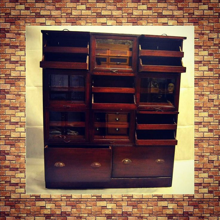 Flip Up Antique Shirt Cabinets at D and A Binder   We have a range of stunning antique cabinets! This is a large shirt display unit with plenty of compartments to store clothing papers materials and more - you'll love it! It is in excellent original condition and would be ideal in an office or luxury shop setting but could be perfect for storage in any home or business. Why not come down to our Islington showroom to see this impressive piece in person? Check our website at DandABinder.co.uk!